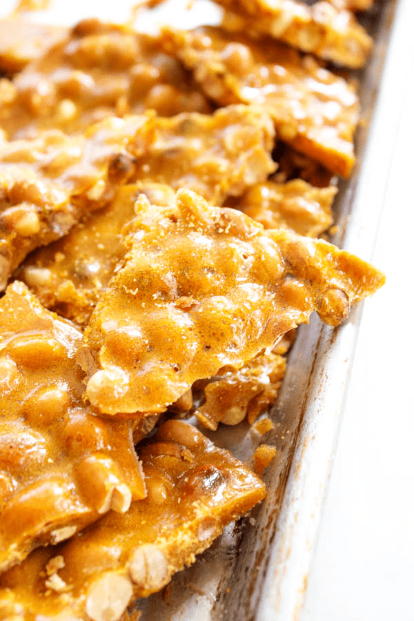 GRANDMA'S PEANUT BRITTLE pieces in pan
