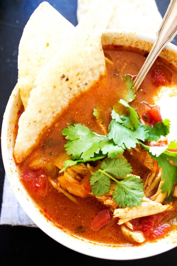 SLOW COOKER AUTHENTIC TORTILLA SOUP bowl with spoon