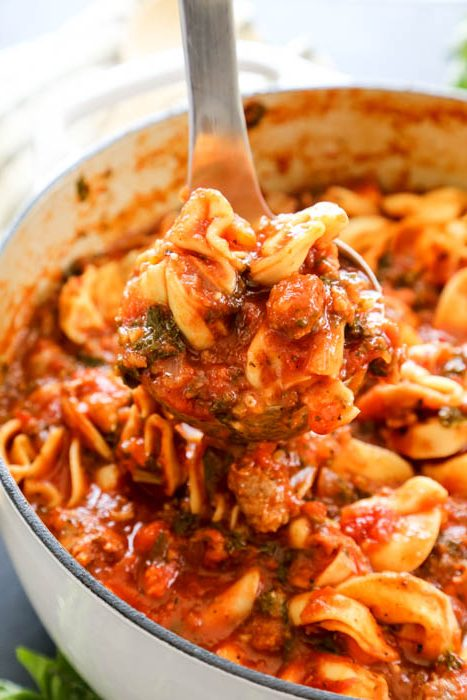 Tuscan Tortellini Soup delicious and comforting. Made with tomatoes, Italian sausage, garlic, onions, kale, and parmesan cheese; you love this simple meal.