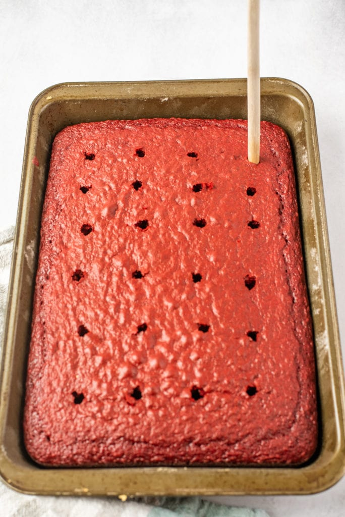 photo of cake with holes poked in it