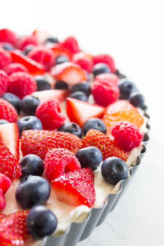 Simple Fruit Tart in pan with strawberries, blueberries and raspberries