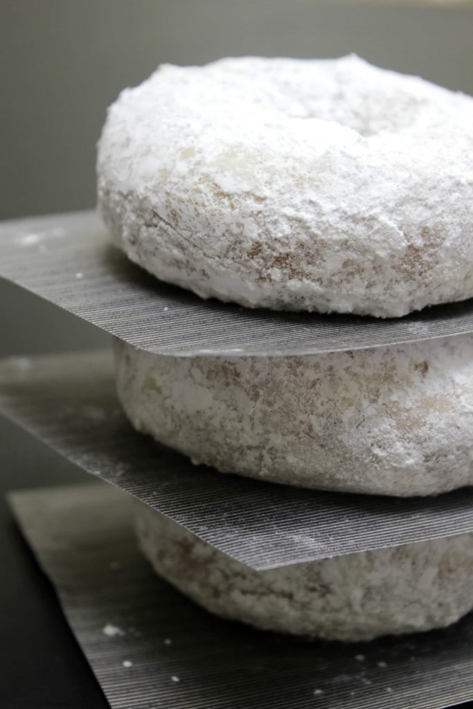 powdered sugar cake donuts stack