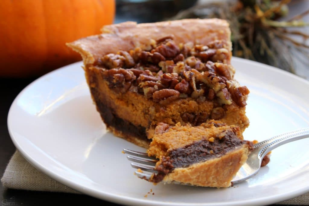 "Chocolate Pecan Pumpkin Pie rich chocolate ""brownie like"" bottom, classic pumpkin pie and topped with pecans all baked into one delicious pie."