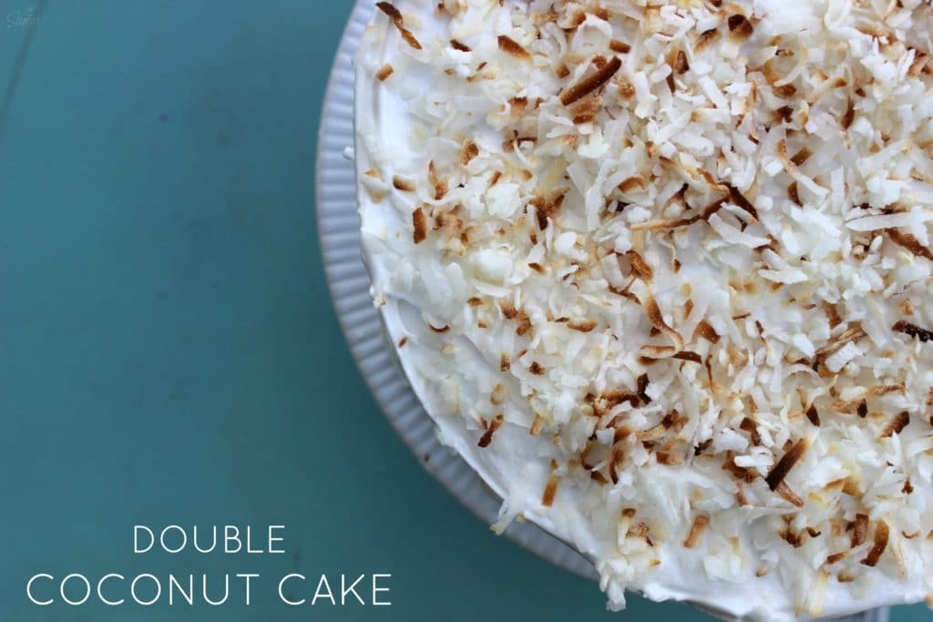 This Double Coconut Cake is a two layer, light coconut cake, that is filled and frosted with coconut meringue frosting and sweetened flaked coconut.