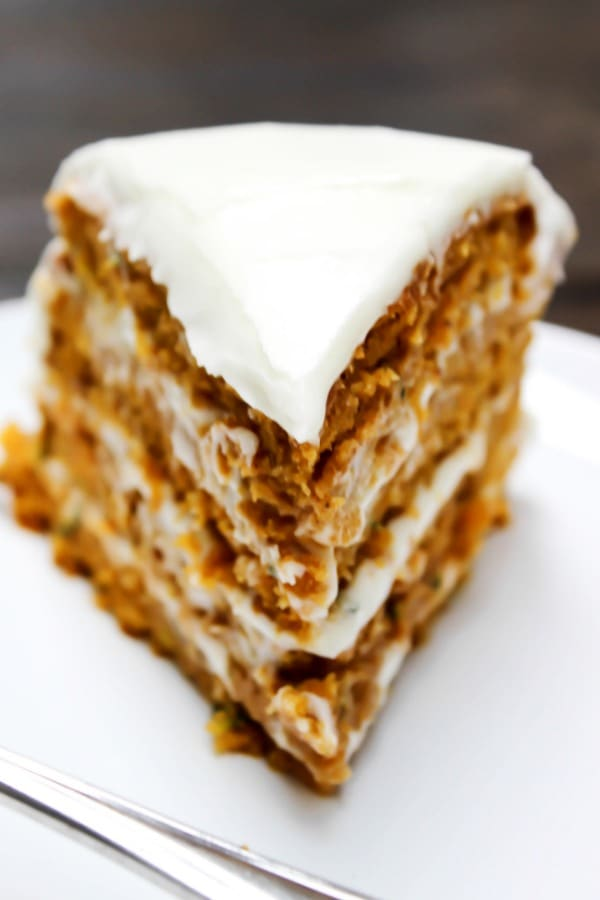 Absolutely dreamy this PUMPKIN ZUCCHINI CAKE is covered in cream cheese frosting, creating the perfect combination for the most delicious cake.