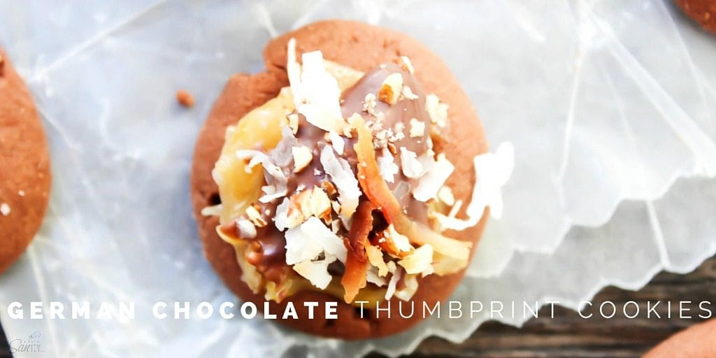 German Chocolate Thumbprint Cookies TWITTERThese Mini German Chocolate Thumbprint Cookies are fudgey-brownie like cookies topped with a chocolate drizzle, toasted coconut, and chopped pecans.