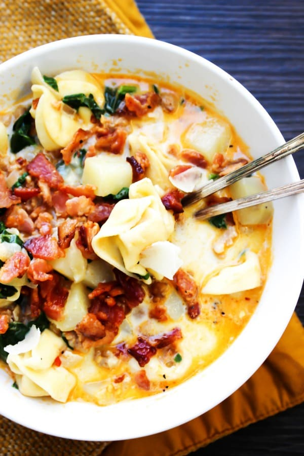 Tortellini Zuppa Toscana - A twist on a classic. Made with three-cheese and fully loaded with bacon and sausage, you'll love this creamy potato soup.