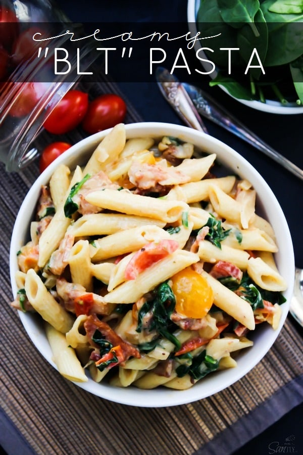 """Creamy """"BLT"""" Pasta is a twist on a traditional BLT. Made with bacon, roasted tomatoes, and spinach, this will have you craving a BLT every single night."""