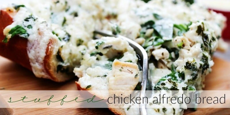 This Stuffed Chicken Alfredo Bread is an easy meal or tasty game day appetizer, filled with chicken, cheese, spinach, and topped with Alfredo sauce.