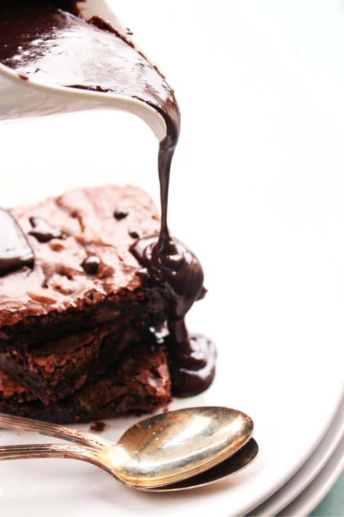 Hot Fudge Sauce pouring over brownies