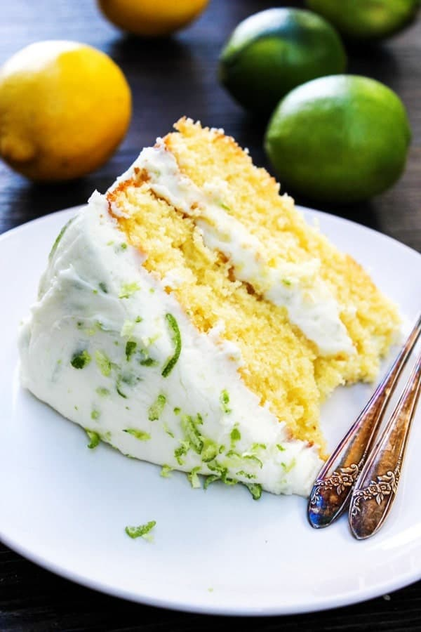 lemon lime layer cake, lemon, lime, cake slice on white plate with forks