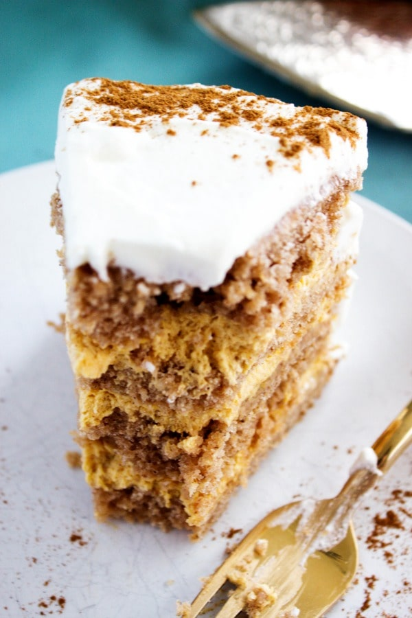 Pumpkin Spice Mousse Cake - decadent layers of pumpkin spice cake and a simplepumpkin mousse filling. A perfect fall dessert, and a Thanksgiving must have. pumpkin-spice-mousse-cake-bite