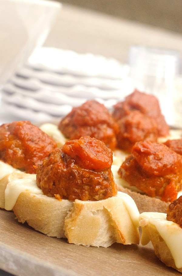 Meatball Crostini baguette slices with meatballs and red sauce