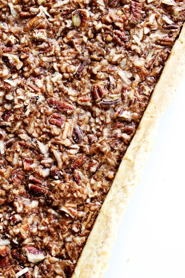 This German Chocolate Slab Pie is the best way to feed a crowd. It's a twist on one of my favorites, with a delicious chocolate, coconut, and pecan filling. german-chocolate-slab-pie-pan