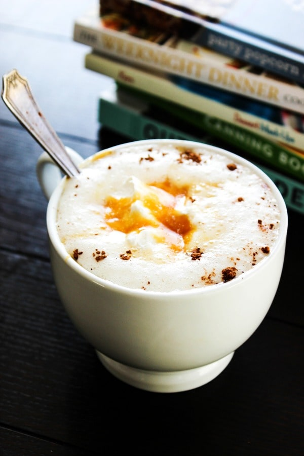 Slow Cooker Sea Salt Caramel Hot Chocolate is a decadent, rich, and creamy hot chocolate that will have caramel lovers swooning.e cup and books