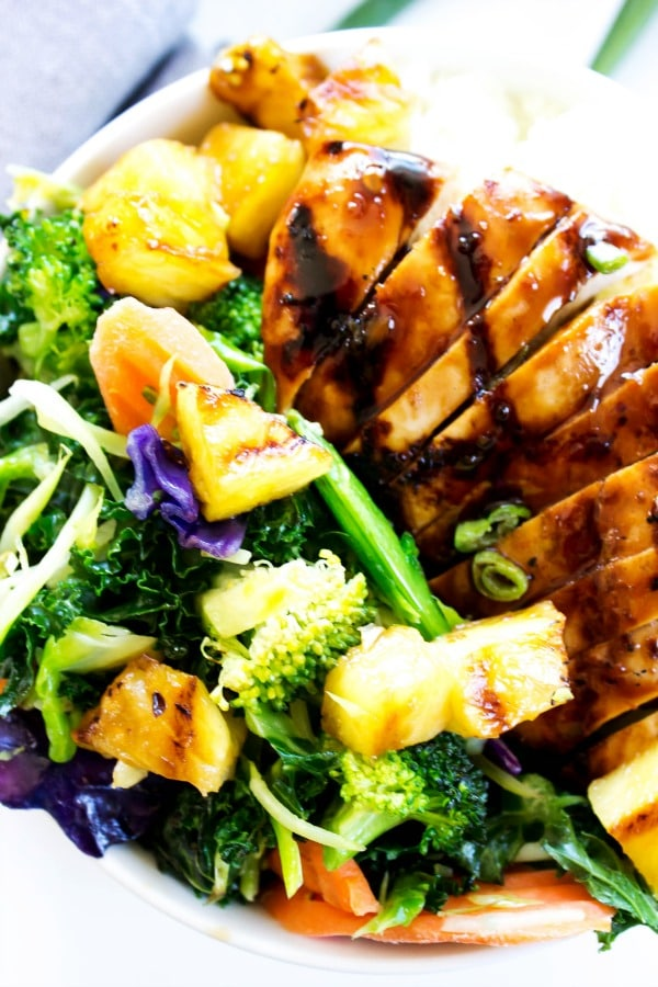 SWEET GINGER TERIYAKI CHICKEN- White bowl, mixes veggies, grey napkin