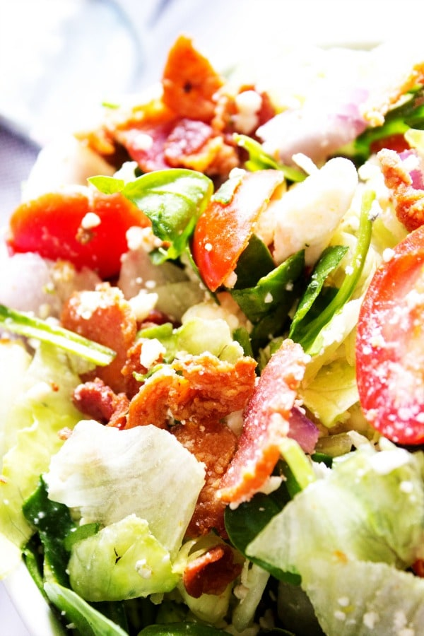 CHOPPED WEDGE SALAD - Glass bowl, napkin in background