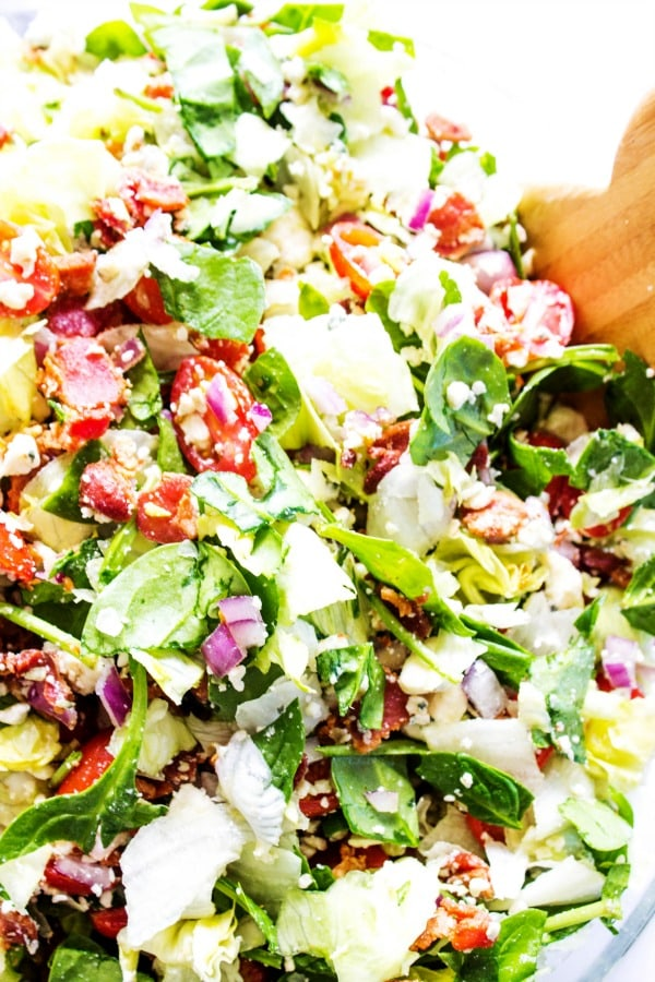 Chopped Wedge Salad is a simple green salad, fully loaded with bacon & blue cheese. Dress it up or down, either way the entire family will love this salad.