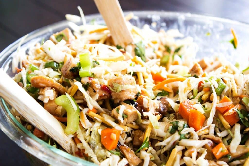 Chopped Asian Salad in bowl with spoons
