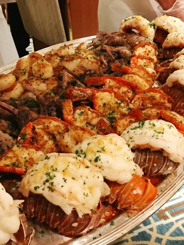 lobster tails, shrimp, crab legs, lamb chops