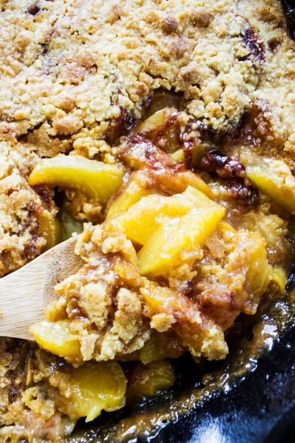 BEST EVER PEACH COBBLER RECIPE. Wooden spoon, caste iron skillet, peach cobbler