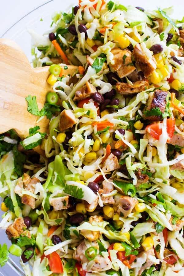 CHOPPED SOUTHWESTERN SALADWooden salad spoon, glass bowl