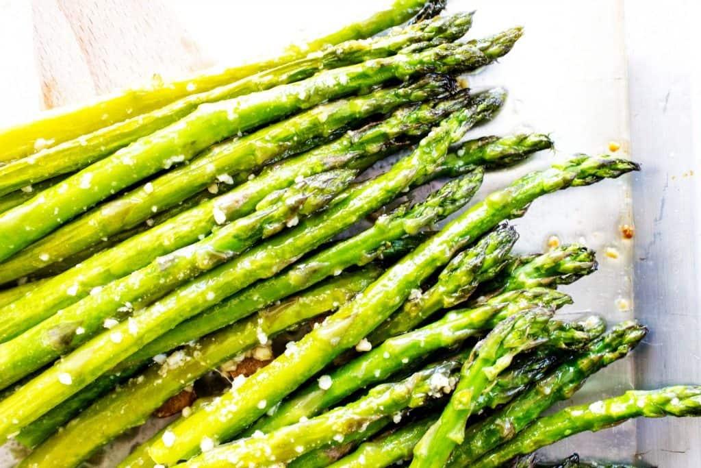 EASY OVEN ROASTED GARLIC ASPARAGUS - Asparagus on metal pan