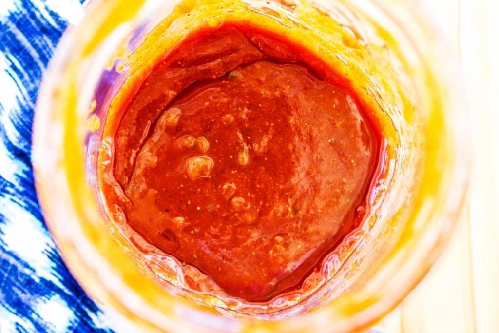 SOUTHWESTERN BARBECUE CHICKEN KABOBS Sauce in large mason jar, blue napkin