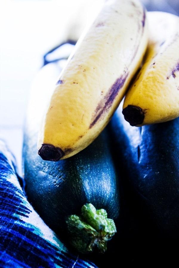 ZUCCHINI BANANA BREAD Zucchini and Bananas on blue napkin