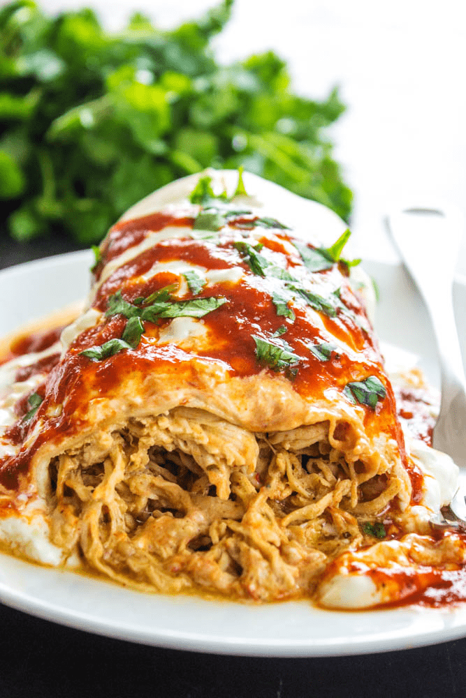 SLOW COOKER MEXICAN SHREDDED CHICKEN aka Copycat Cafe' Rio Chicken is simple, versatile and insanely delicious. Wrap it up, smother it in cheese and devour it.