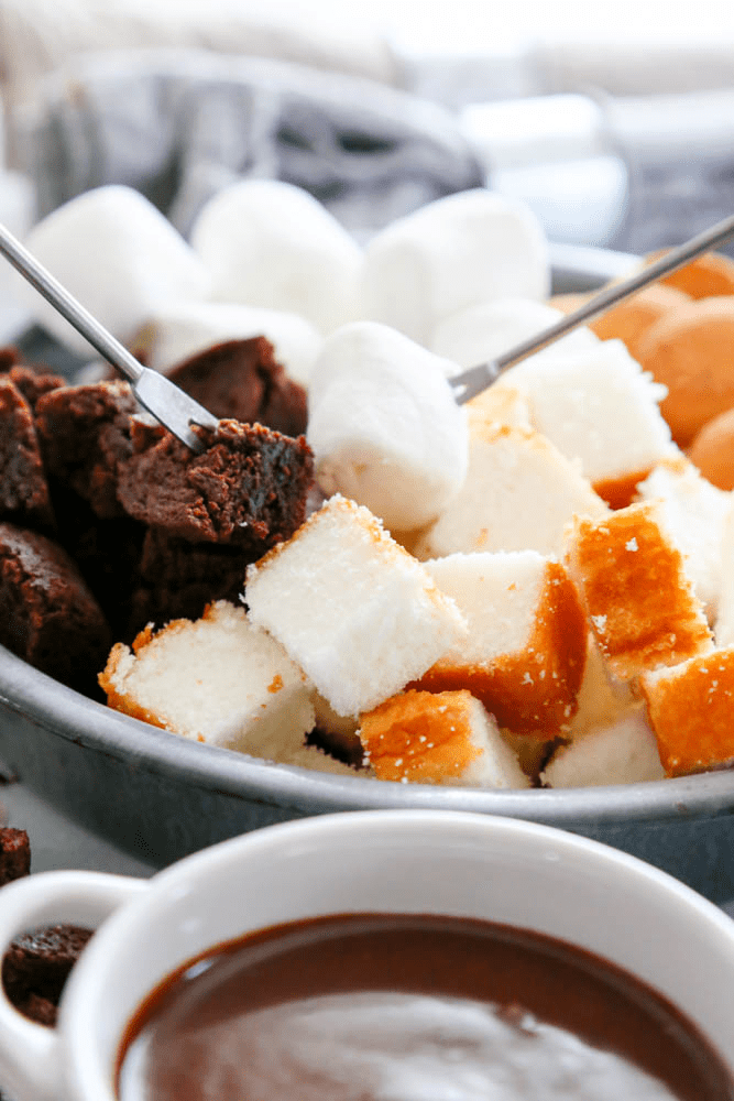 chocolate, fondue, peanut butter, marshmallows, angel food cake, brownies, white bowl, skewers