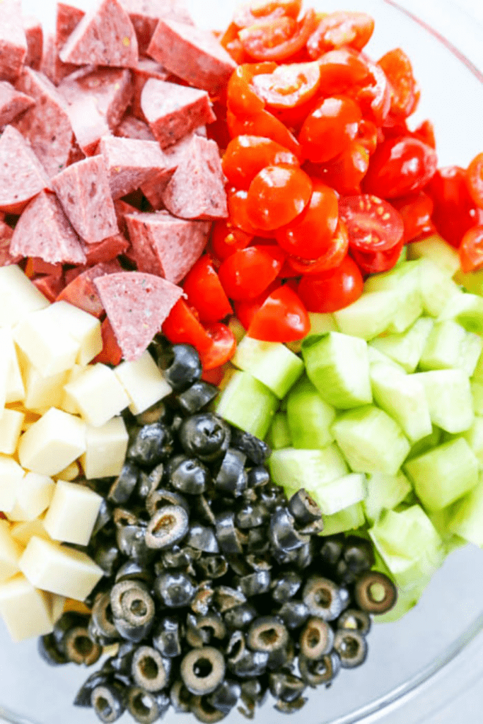 Easy Pasta Salad with Italian dressing, penne pasta, tomatoes, cucumbers, cheese, olives and salami