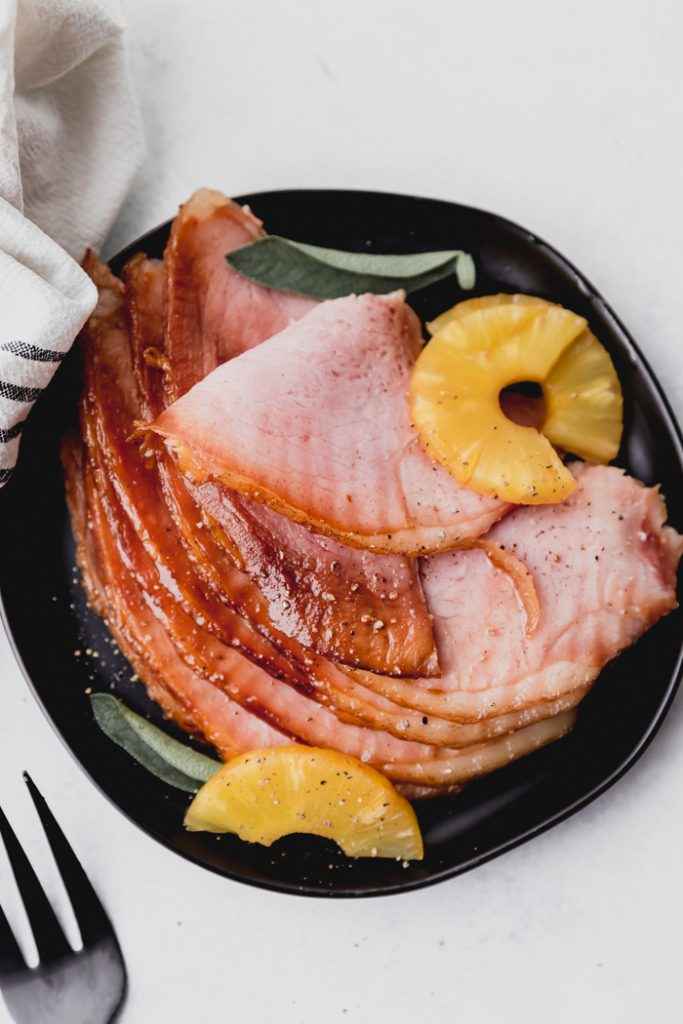 plate of holiday ham with pineapple slices