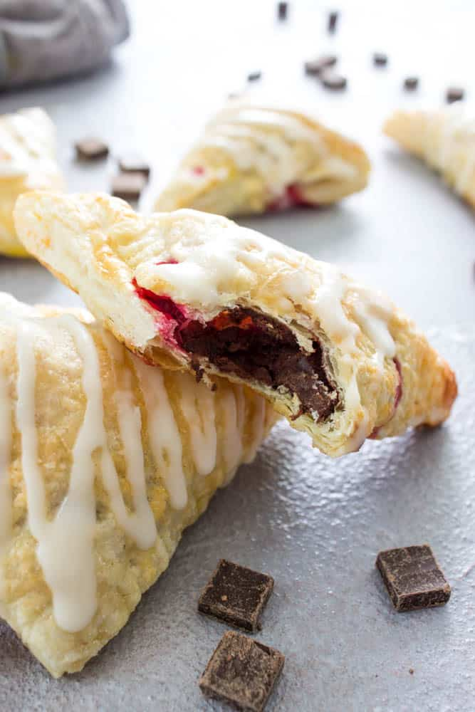 Chocolate Raspberry Turnovers - flaky pastry dough stuffed with dark chocolate and fresh raspberries. This simple recipe is ready in under 30 minutes.
